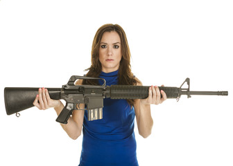 Young woman with assault rifle