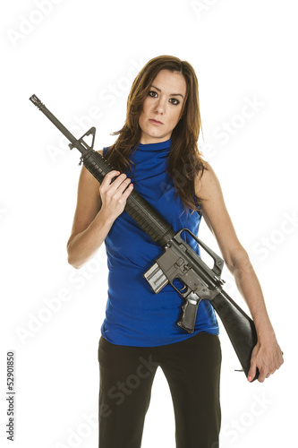 Young attractive woman with assault rifle