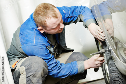 auto repair man flatten metal body car