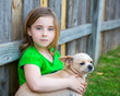 Blond happy girl with her chihuahua doggy portrait