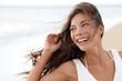Happy girl on beach - candid young woman joyful