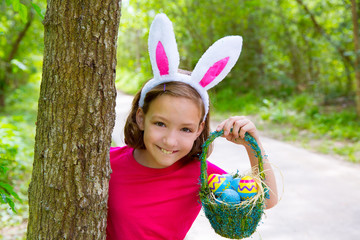 Easter girl with eggs basket and funny bunny face