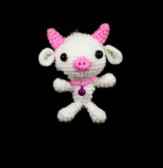 handmade crochet white pig with pink nose doll on black backgrou