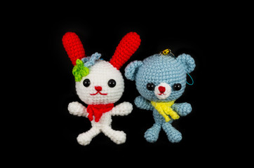 handmade crochet white rabbit with red ear and blue bear doll on
