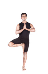 Yoga tree pose on white