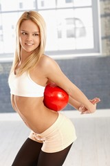Pretty girl exercising with ball