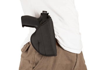 Close-up of a man with holster and a gun
