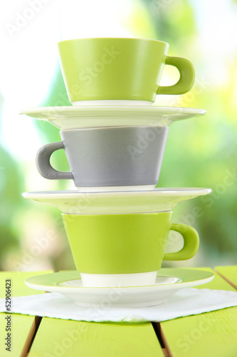 Three cups on nature background