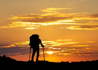 Silhouette of a tourist in the montains. Sport and active life