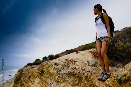 Woman Hiking on Ocean Cliffs