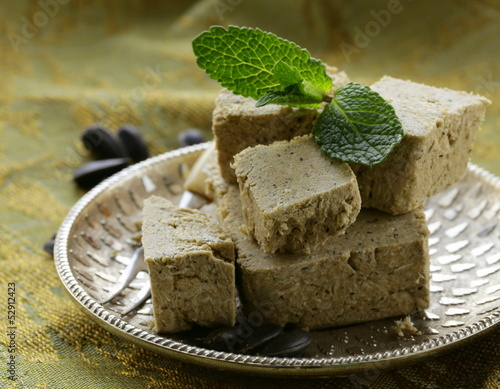 Traditional oriental dessert halva - sunflower seeds and sugar