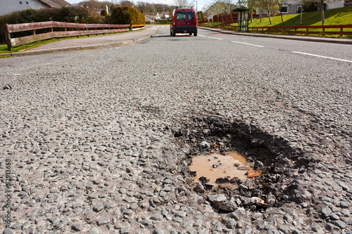 Pot hole in residential road surface