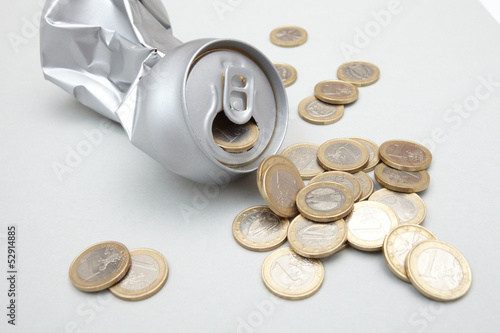 Crushed Aluminum Can with coins