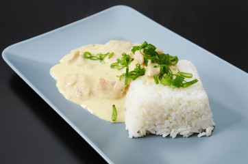 Chicken strips in creamy mushroom sauce, served with rice