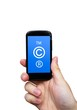 Copyright, trademark symbols  on smart phone. Security and pirac