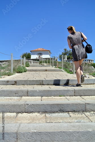 Girl walking to pousada in Cascais, Portugal