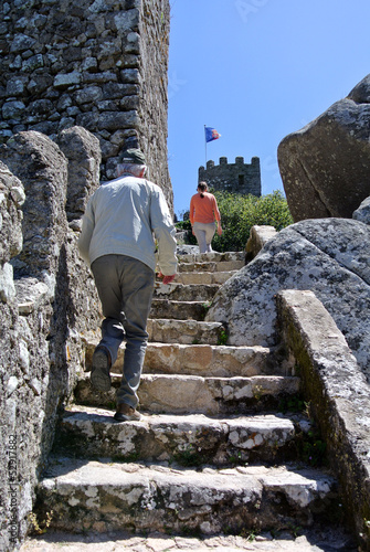 Golden ager climbing stairs in Sintra, Portugal