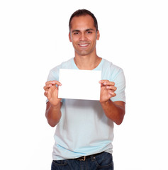 Smiling latin man holding a white card