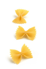 three bow tie pasta on white background
