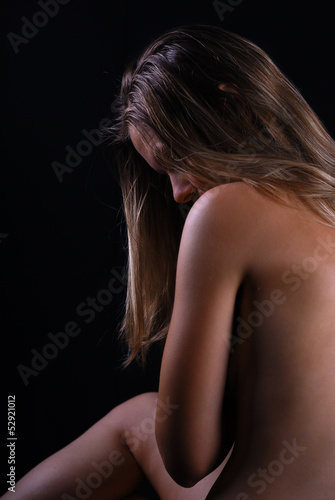 Portrait of the beautiful woman with naked back