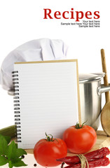 Blank recipe book and vegetables