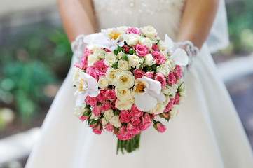 Wedding bouquet in hands of the bride