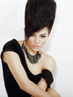 Sentiment. Bright Woman with Black Updo Hair and Necklace