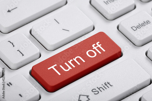 Red key of the computer. Turn off