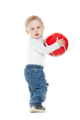 Little boy playing with a ball.  beautiful little kid  play with