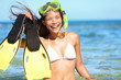 snorkeling fun on beach - woman showing fins