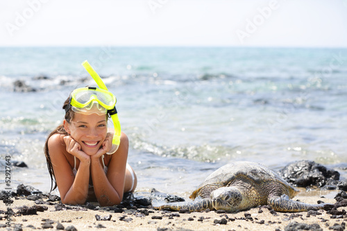Hawaii girl swimming snorkeling with sea turtles