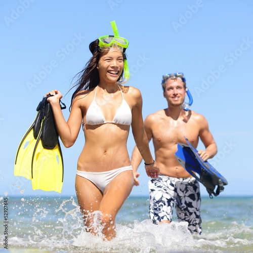 Beach couple having fun on vacation travel snorkel
