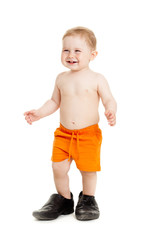 Little baby  boy on the big shoes  Isolated on white