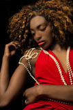 Beautiful exotic African American woman wearing a red dress drap