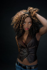 Sultry exotic African American woman with big hair and red lips