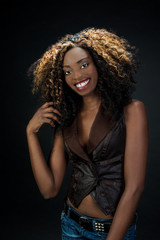 Beautiful exotic African American woman with a lovely natural sm