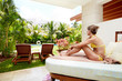 Relaxing woman at caribbean resort.
