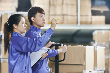 two chinese workers in warehouse