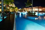 Swimming pool at night. poster