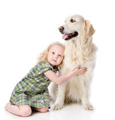 girl embraces a Golden Retriever. looking away. isolated