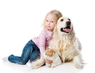 girl playing with pets - dog and cat. looking away. isolated