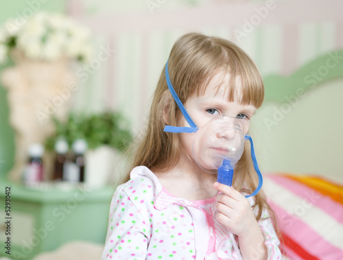 little girl with a mask for inhalations