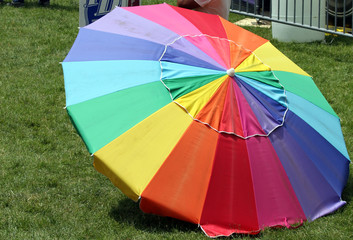 A Rainbow-Colored Parasol on green grass