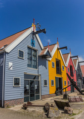 Colorful houses against a bright blue sky