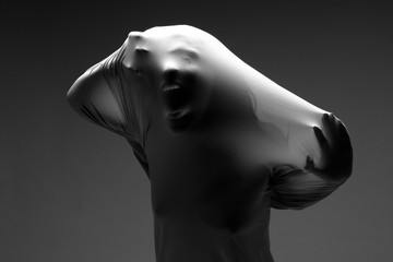 Scary Horror Image of a Woman Trapped in Fabric