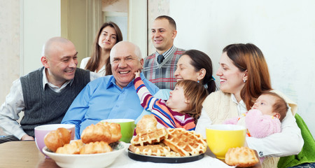 happy multigeneration family or group of friends