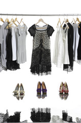 casual fashion clothing hanging on hangers and boots