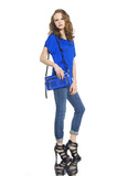 beautiful fashion woman in jeans with blue bag posing
