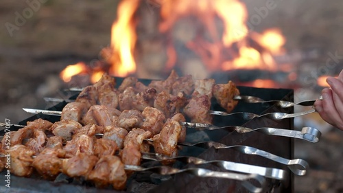 fresh kebab prepares on the fire outdoors