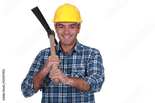 happy bricklayer holding pickaxe isolated on white